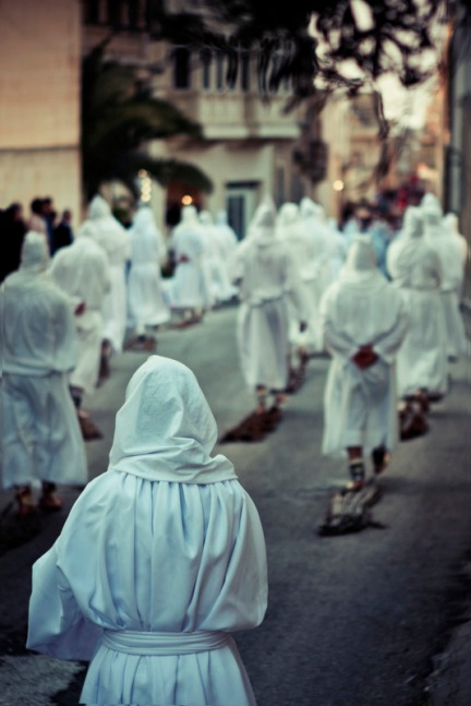 To a tourist, it might look like the Ku Klux Klan descends on our islands on this day...
