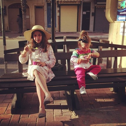 Note Maia's crossed legs. She does that every time she wears that hat.