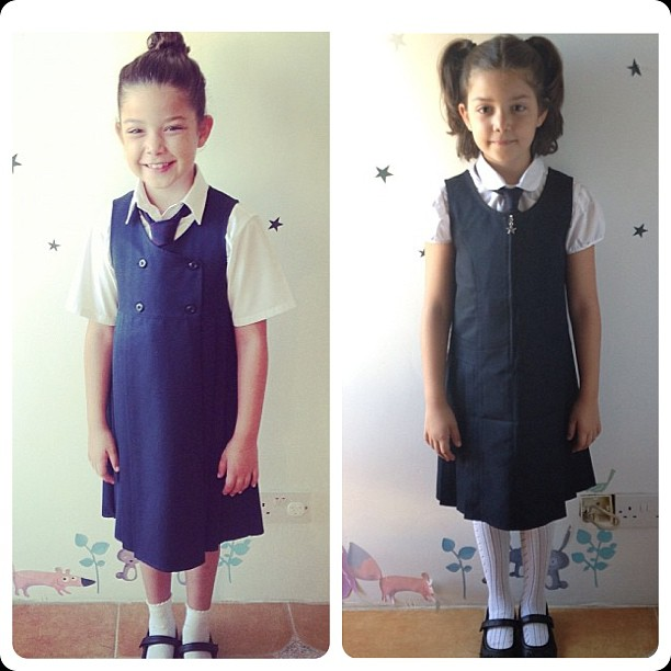 First day of school 2012 (left) and this year's on the right. I was shocked at how much she's grown over this year. You can tell by the position of the stars behind her. You can also tell that those peeling, faded stickers need to be changed.